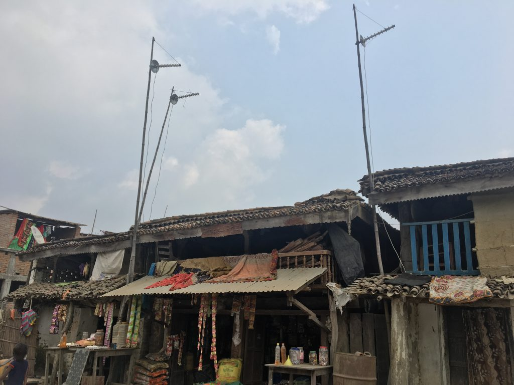 radio masts rising above buildings in India